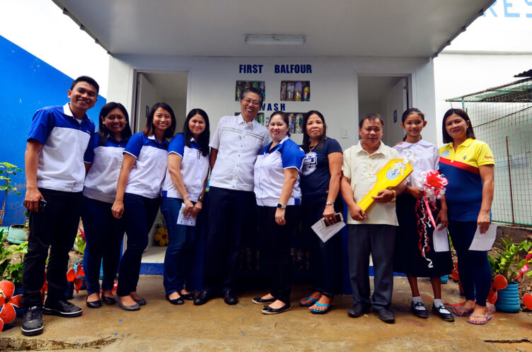 (L-R) Project WASH Team Gio Losloso, Hanna Aguilar, Tine Velez, and Anchel Cruz (not in photo are Jaide Pagador and Andre Cruz), First Balfour HR Head Caloy Salonga, Finance Sr. Manager and HES Alumni Association President Clarisa Timog, Brgy. Kagawad Ruth Licudan, HES Teacher Joel Zamora, HES Student Government President Lucia Marie Gimena, and HES PTA Vice President Marilyn Rocero.